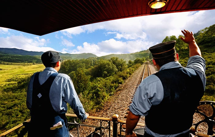 Conductor in the caboose of the Cumbres & Toltec Scenic Railroad train