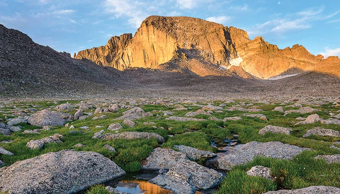 Longs Peak catches the sun on an August morning in Rocky Mountain National Park