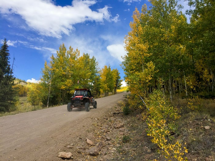 Riding an off-highway vehicle (OHV) on the Bachelor Loop in the Rio Grande National Forest near South Park, Colorado